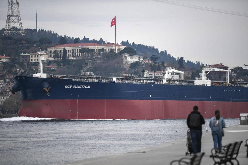 """A ship sails through the Bosphorus Strait on April 23,2021 in Istanbul, on route to the Black Sea. Not content with shaping Turkey's history, President Recep Tayyip Erdogan is about to change its geography too by building an alternative to the Bosphorus -- his most outlandish """"crazy"""" project yet. Critics accuse Erdogan of pursuing a vanity project that will open up Istanbul to unbridled construction and put the government into deep and largely unnecessary debt. / AFP / Ozan KOSE"""