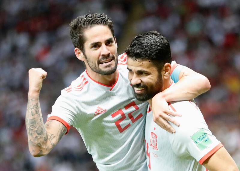 epaselect epa06825582 Diego Costa (R) of Spain celebrates with teammate Isco after scoring the opening goal during the FIFA World Cup 2018 group B preliminary round soccer match between Iran and Spain in Kazan, Russia, 20 June 2018.  (RESTRICTIONS APPLY: Editorial Use Only, not used in association with any commercial entity - Images must not be used in any form of alert service or push service of any kind including via mobile alert services, downloads to mobile devices or MMS messaging - Images must appear as still images and must not emulate match action video footage - No alteration is made to, and no text or image is superimposed over, any published image which: (a) intentionally obscures or removes a sponsor identification image; or (b) adds or overlays the commercial identification of any third party which is not officially associated with the FIFA World Cup)  EPA/DIEGO AZUBEL   EDITORIAL USE ONLY