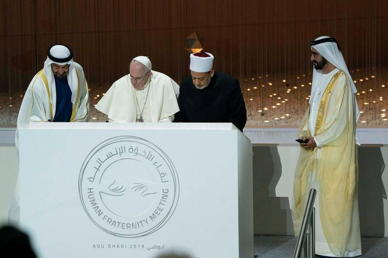 ABU DHABI, UNITED ARAB EMIRATES - February 4, 2019: Day two of the UAE papal visit - HH Sheikh Mohamed bin Rashid Al Maktoum, Vice-President, Prime Minister of the UAE, Ruler of Dubai and Minister of Defence (R), HH Sheikh Mohamed bin Zayed Al Nahyan, Crown Prince of Abu Dhabi and Deputy Supreme Commander of the UAE Armed Forces (L), His Holiness Pope Francis, Head of the Catholic Church (2nd L) and His Eminence Dr Ahmad Al Tayyeb, Grand Imam of the Al Azhar Al Sharif (2nd R), sign a commemorative stone, at The Founders Memorial ( Hamad Al Mansoori / Ministry of Presidential Affairs ) ---