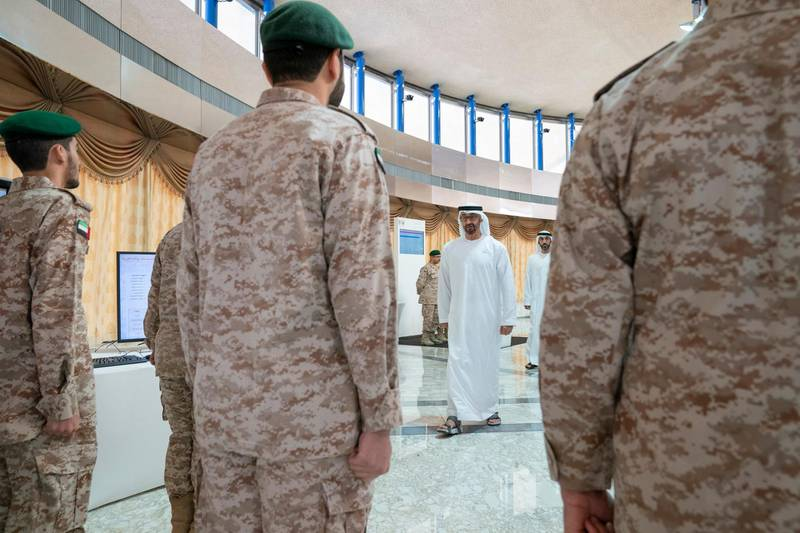 ABU DHABI, UNITED ARAB EMIRATES - April 28, 2019: HH Sheikh Mohamed bin Zayed Al Nahyan, Crown Prince of Abu Dhabi and Deputy Supreme Commander of the UAE Armed Forces (back C), attends e-skills exhibition for national service recruits, at Armed Forces Officers Club. ( Mohamed Al Hammadi / Ministry of Presidential Affairs ) ---