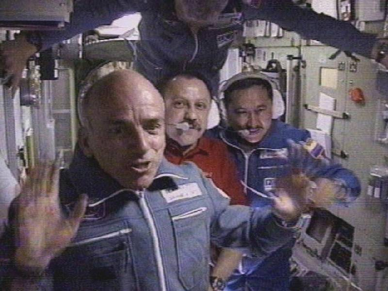 388502 03: The worlds first space tourist Dennis Tito waves in front of the International Space Station crew shortly after his arrival to the station April 30, 2001 in this image from television. In the background are space station commander Yuri Usachev, center, bottom, Russian cosmonauts Talgat Musabayev, right, and Yuri Baturin, center, top. Tito is paying as much as $20 million for this adventure of a lifetime. (Photo by RTV/Oleg Nakishin/Newsmakers