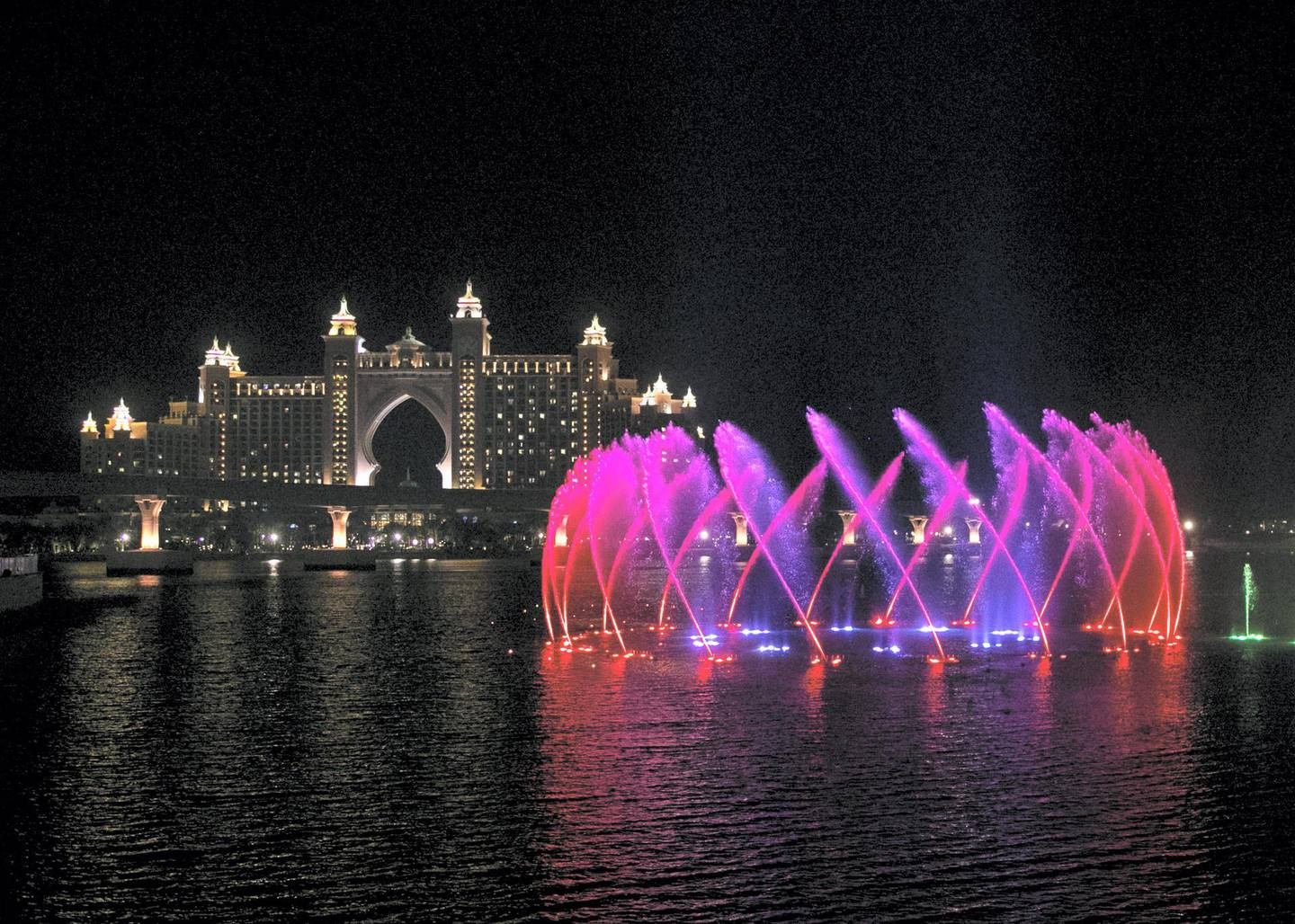 DUBAI, UNITED ARAB EMIRATES. 18 NOVEMBER 2020. The Palm Fountain comes alive to the theme of Oman National Day on 18 November. (Photo: Reem Mohammed/The National)Reporter:Section: