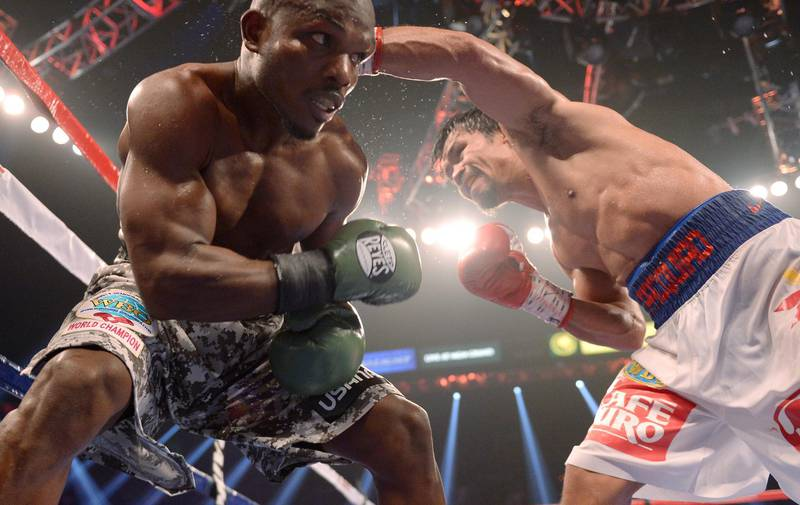 Timothy Bradley (L) of US and Manny Pacquiao of Philippines fight during their  WBO World Welterweight Championship title match at the MGM Grand Arena in Las Vegas, Nevada on April 12,2014.AFP PHOTO /JOE KLAMAR (Photo by JOE KLAMAR / AFP)