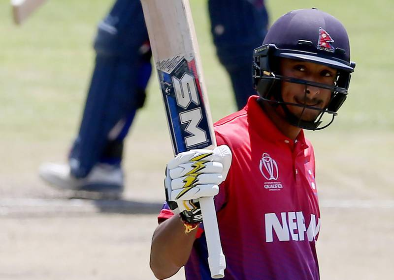 BULAWAYO, ZIMBABWE - MARCH 08: Paras Khadka of Nepal reacts after reaching his 50 during the ICC Cricket World Cup Qualifier between Scotland v Nepal at Queens Sports Club on March 8, 2018 in Bulawayo, Zimbabwe. (Photo by Nigel Roddis - ICC/ICC via Getty Images)