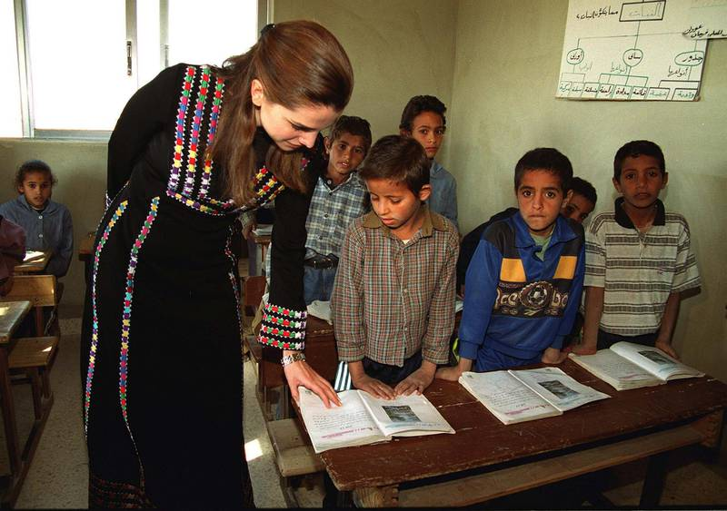 383497 01: Queen Rania of Jordan talks to a child in a schoolroom December 17, 2000 in Kerak, south of Amman, Jordan. Rania contributed donations for the needy families in the holy Muslim fasting month of Ramadan. (Photo by Salah Malkawi/Newsmakers)