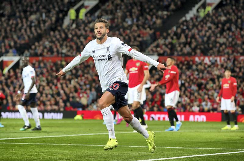 MANCHESTER, ENGLAND - OCTOBER 20:  Adam Lallana of Liverpool celebrates after scoring his sides first goal during the Premier League match between Manchester United and Liverpool FC at Old Trafford on October 20, 2019 in Manchester, United Kingdom. (Photo by Alex Livesey/Getty Images)