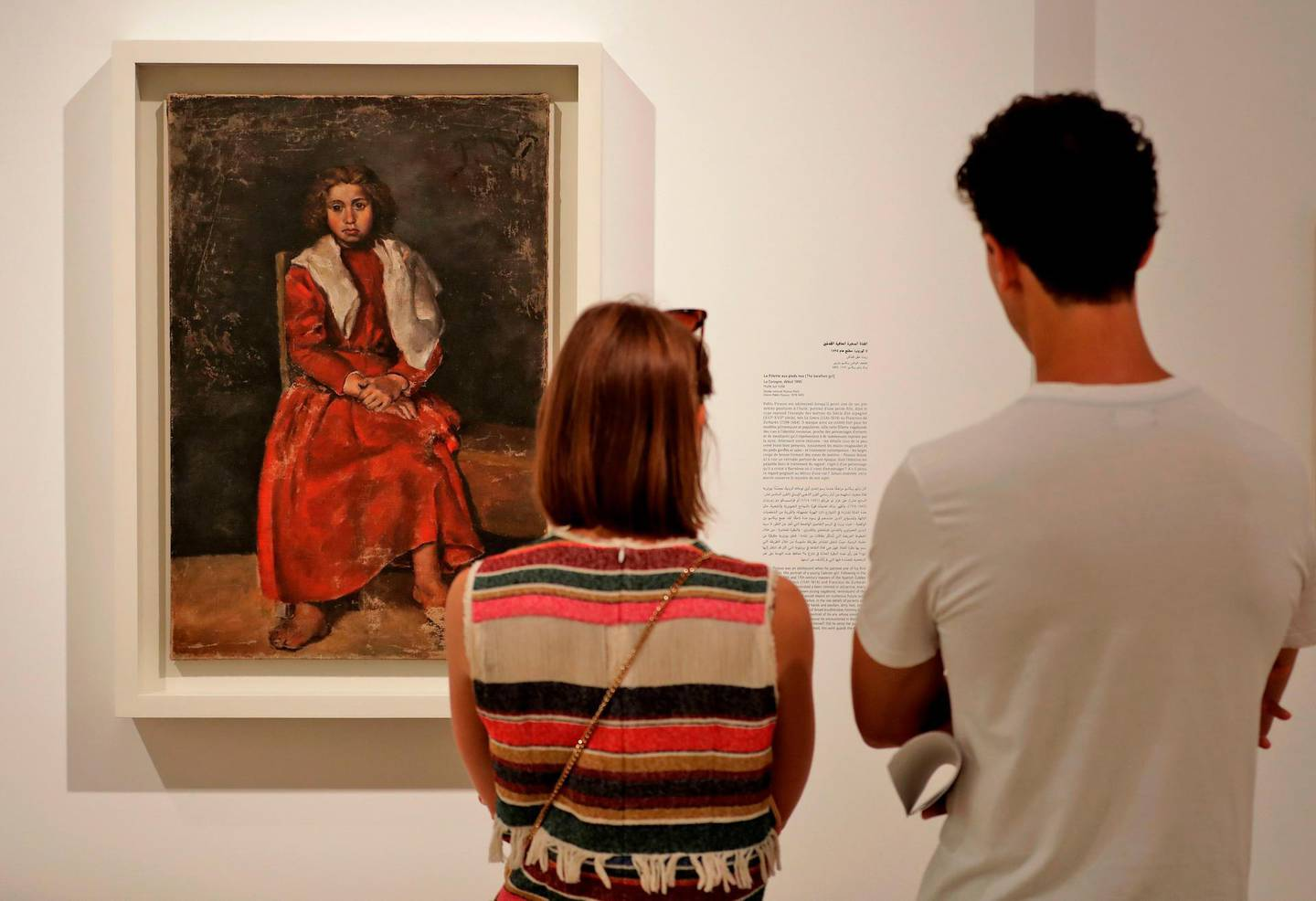 """Visitors observe the artwork """"The Barefoot Girl"""" (1895) by Spanish artist Pablo Picasso  displayed at the Sursock Museum in the Lebanese capital Beirut on September 27, 2019. Lebanon launched its first exhibition of late Spanish artist Pablo Picasso's works this month with more than 20 works centred around the theme of family, organisers said. The exhibition will run until January next year.  / AFP / JOSEPH EID"""