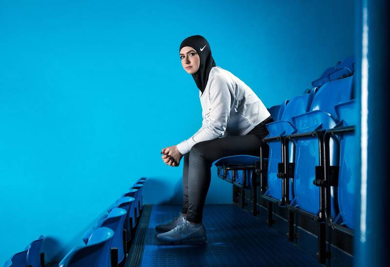 In this undated image provided by Nike, figure skater Zahra Lari model wears Nike's new hijab for Muslim female athletes. The pull-on hijab is made of light, stretchy fabric that includes tiny holes for breathability and an elongated back so it will not come untucked. It will come in three colors: black, vast grey and obsidian. Beaverton-based Nike says the hijab will be available for sale next year.  (Nike via AP) *** Local Caption ***  Nike_Hijab_97593.jpg-d976c.jpg na09mr-p13-Nike hijab.jpg