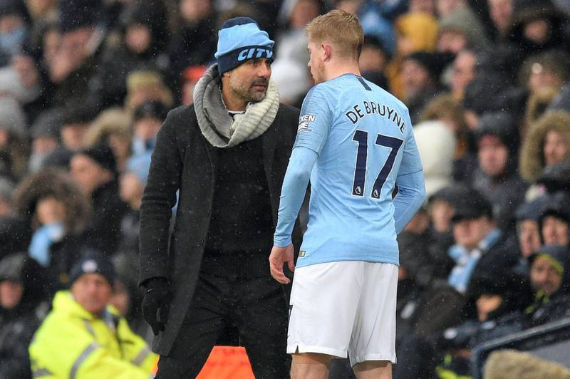 Manchester City's Spanish manager Pep Guardiola gives instructions to Manchester City's Belgian midfielder Kevin De Bruyne during the English Premier League football match between Manchester City and Everton at the Etihad Stadium in Manchester, north west England, on December 15, 2018. (Photo by Oli SCARFF / AFP) / RESTRICTED TO EDITORIAL USE. No use with unauthorized audio, video, data, fixture lists, club/league logos or 'live' services. Online in-match use limited to 120 images. An additional 40 images may be used in extra time. No video emulation. Social media in-match use limited to 120 images. An additional 40 images may be used in extra time. No use in betting publications, games or single club/league/player publications. /