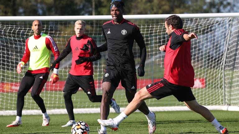 An image that illustrates this article Pogba leads buoyant Man United training for Liverpool showdown