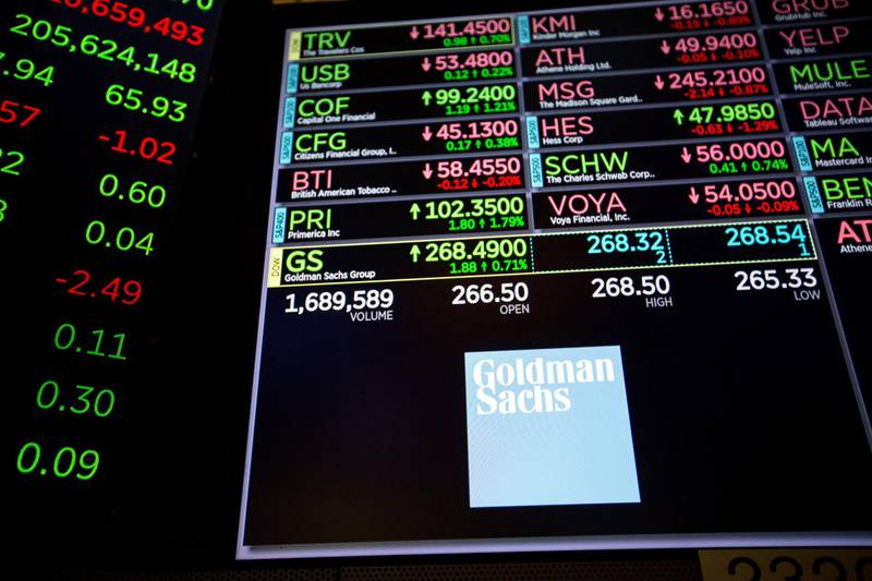 A monitor displays Goldman Sachs Group Inc. signage on the floor of the New York Stock Exchange (NYSE) in New York, U.S., on Friday, March 16, 2018. U.S. stocks broke out of their four-day slump as traders looked past White House turmoil to reports of better-than-expectedfactoryoutput, which pushed 10-year Treasury yields higher and helped the dollar erase losses. Photographer: Michael Nagle/Bloomberg