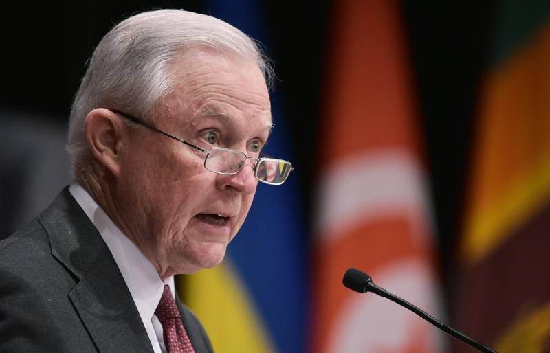 """(FILES) This file photo taken on December 4, 2017 shows US Attorney General Jeff Sessions speaking during the inaugural Global Forum on Asset Recovery at the  International Finance Corporation in Washington, DC. The US Justice Department announced January 11, 2018 creation of a special task force to investigate what it called """"narcoterrorism"""" by the powerful Lebanese movement Hezbollah. The unit will comprise specialists on money-laundering, drug trafficking, terrorism and organized crime, targeting Iran ally Hezbollah's sprawling network, whose reach extends across Africa and into Central and South America, the department said.""""The Justice Department will leave no stone unturned in order to eliminate threats to our citizens from terrorist organizations and to stem the tide of the devastating drug crisis,"""" said Attorney General Jeff Sessions.  / AFP PHOTO / MANDEL NGAN"""