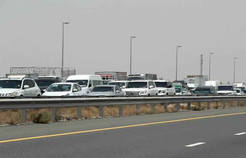 DUBAI, UNITED ARAB EMIRATES , July 15 – 2020 :- Traffic jam at the Dubai border going towards Abu Dhabi on Sheikh Zayed road in Dubai. (Pawan Singh / The National) For News/Online