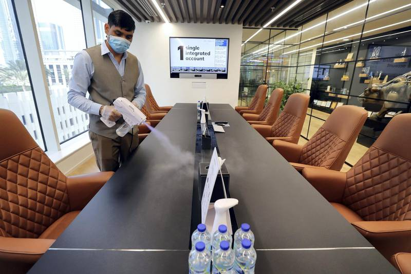 Dubai, United Arab Emirates - Reporter: N/A. Standalone. Covid-19/Coronavirus. Rohit an employee at Century Financial sterilises a conference room. Employees are required to wear masks, gloves and overshoes. Thursday, August 27th, 2020. Dubai. Chris Whiteoak / The National