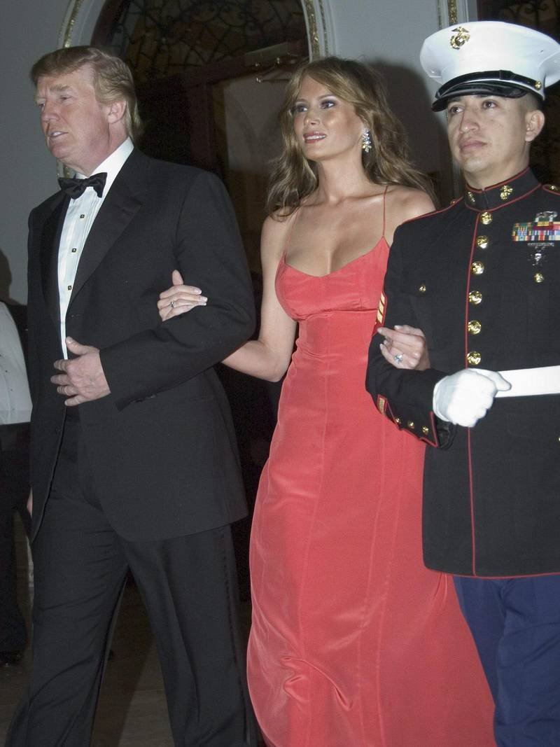 epa000358412 Donald Trump and his wife Melania are escort by a Marines as they attend  the International Red Cross Ball on Saturday 29 January 2005, in Palm Beach, Florida, USA. Founded by Marjorie Merriweather Post 48 years ago and held at her original residence and now Donald Trump's Mir-a-Largo Club. This event is benefiting the America Red Cross Greater West Palm Beach Area Chapter to provide relief and educational services throughout our community.  EPA/JOANNA GLEASON