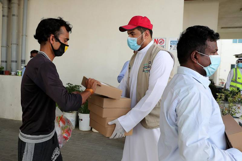 DUBAI, UNITED ARAB EMIRATES , May 01 – 2020 :- Volunteers from Beit Al Khair Society distributing the food packets at one of the labour camp in Al Muhaisnah area in Dubai. This is a part of Mohammed Bin Rashid Al Maktoum 10 Million Meals Global Initiative. Today they are delivering 1000 food packets from Al Nadeg restaurant in Deira Dubai. Total 12000 food packets will be deliver in different labour camps in Dubai. (Pawan Singh / The National) For News/Online/Instagram. Story by Anam