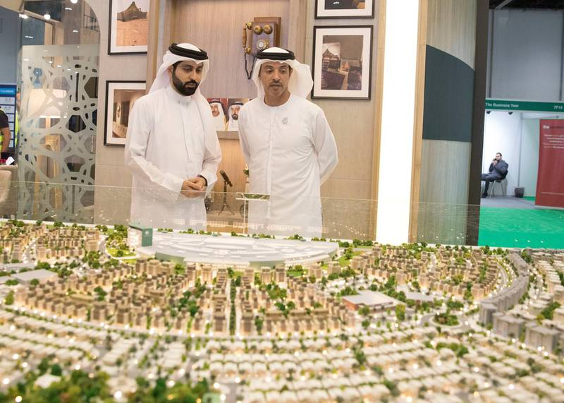 ABU DHABI, UNITED ARAB EMIRATES - April 16, 2019: HH Sheikh Hazza bin Zayed Al Nahyan, Vice Chairman of the Abu Dhabi Executive Council (R), attends the opening of Cityscape Abu Dhabi, at Abu Dhabi National Exhibition Centre (ADNEC).   ( Mohammed Al Blooshi for Ministry of Presidential Affairs ) ---