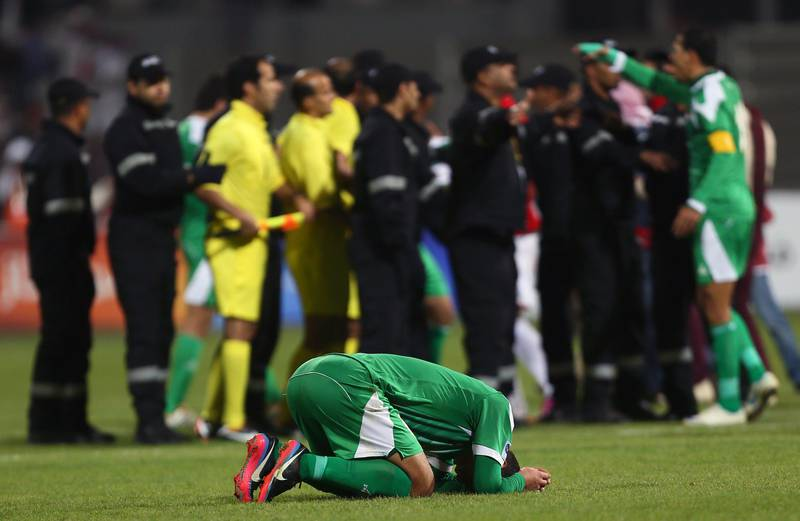 An Iraqi player reacts after his team lost the final of the 21st Gulf Cup on January 18, 2013 in Manama. United Arab Emirates won 2-1 against  Iraq.  AFP PHOTO/MARWAN NAAMANI  *** Local Caption ***  291128-01-08.jpg