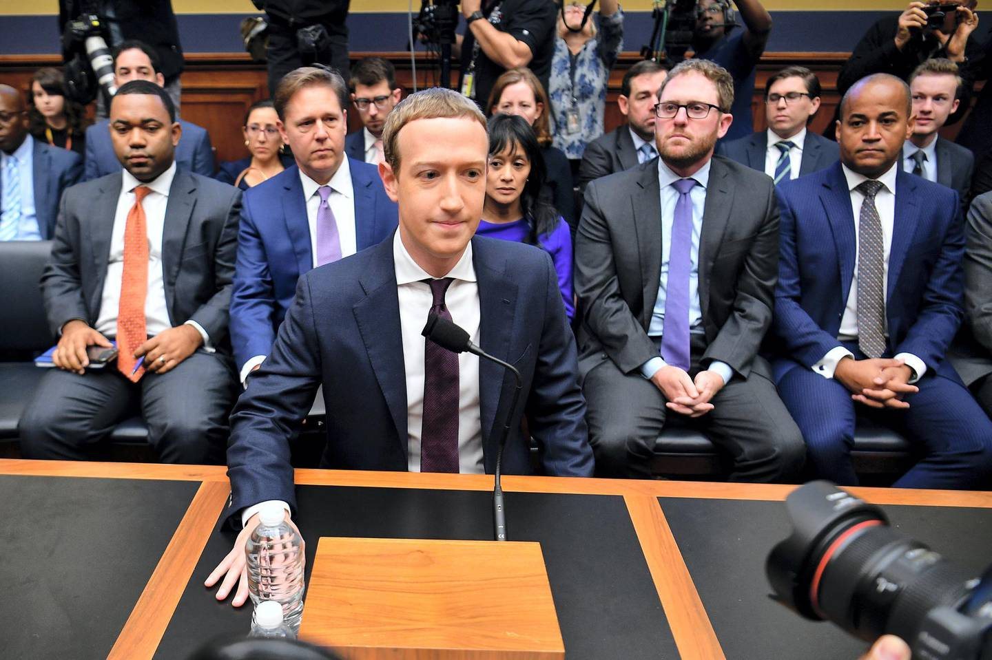 """Facebook Chairman and CEO Mark Zuckerberg arrives to testify before the House Financial Services Committee on """"An Examination of Facebook and Its Impact on the Financial Services and Housing Sectors"""" in the Rayburn House Office Building in Washington, DC on October 23, 2019. (Photo by MANDEL NGAN / AFP)"""