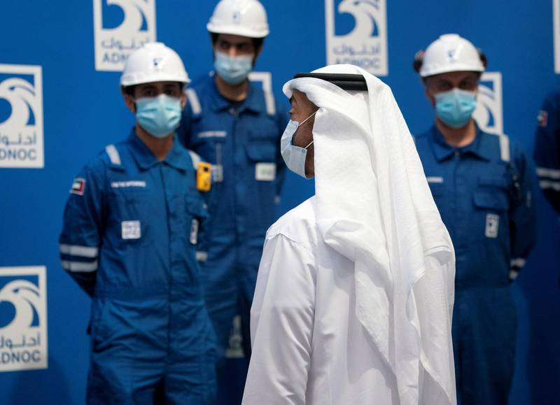 AL RUWAIS, WESTERN REGION OF ABU DHABI, UNITED ARAB EMIRATES - June 17, 2020: HH Sheikh Mohamed bin Zayed Al Nahyan, Crown Prince of Abu Dhabi and Deputy Supreme Commander of the UAE Armed Forces (R), witnesses the progress of ADNOC projects in Al Ruwais.  ( Mohamed Al Hammadi / Ministry of Presidential Affairs ) ---