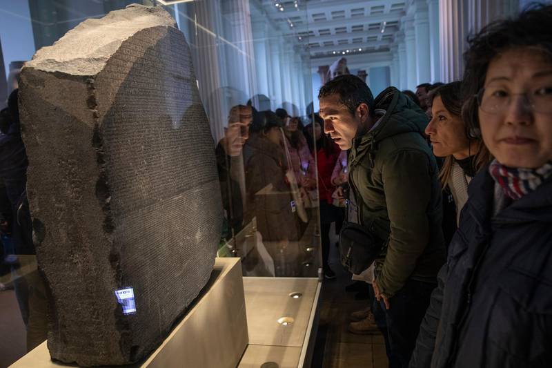 LONDON, ENGLAND - NOVEMBER 22: The Rosetta Stone is displayed at The British Museum on November 22, 2018 in London, England. The Rosetta Stone is one of the museums most important pieces playing a vital role in historians understanding hieroglyphics for the first time as they sit alongside Demotic and Ancient Greek scripts.  (Photo by Dan Kitwood/Getty Images)