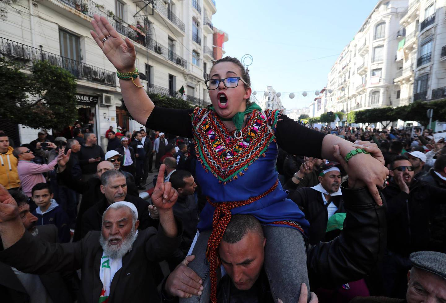 epa08237347 Algerians shout slogans as they march to mark the first anniversary of the popular protests in Algiers, Algeria, 22 February 2020. Algerian protesters this weekend are marking the first anniversary of the protest movement that began on 16 February 2019 after Abdelaziz Bouteflika announced his candidacy for a fifth presidential term. The protesters continue to press for their demands for a complete change of the ruling elite and an end to corruption.  EPA/MOHAMED MESSARA