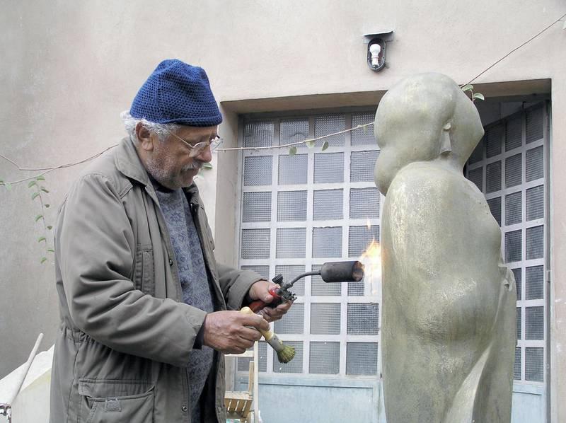 Adam Henein working on an Umm Kulthum sculpture. Circa 2009. Image courtesy Karim Francis Gallery, Cairo