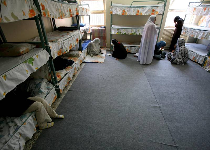 Iranian women prisoners sit inside their cell in Tehran's Evin prison June 13, 2006. Iranian police detained 70 people at a demonstration in favour of women's rights, the judiciary said on Tuesday, adding it was ready to review reports that the police had beaten some demonstrators.  REUTERS/Morteza Nikoubazl (IRAN)