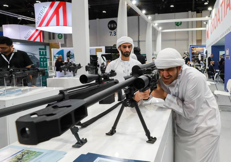 Abu Dhabi, U.A.E., February 18, 2019. INTERNATIONAL DEFENCE EXHIBITION AND CONFERENCE  2019 (IDEX) Day 2--  Visitors check out one of the 50mm sniper rifles at the exhibition.Victor Besa/The National