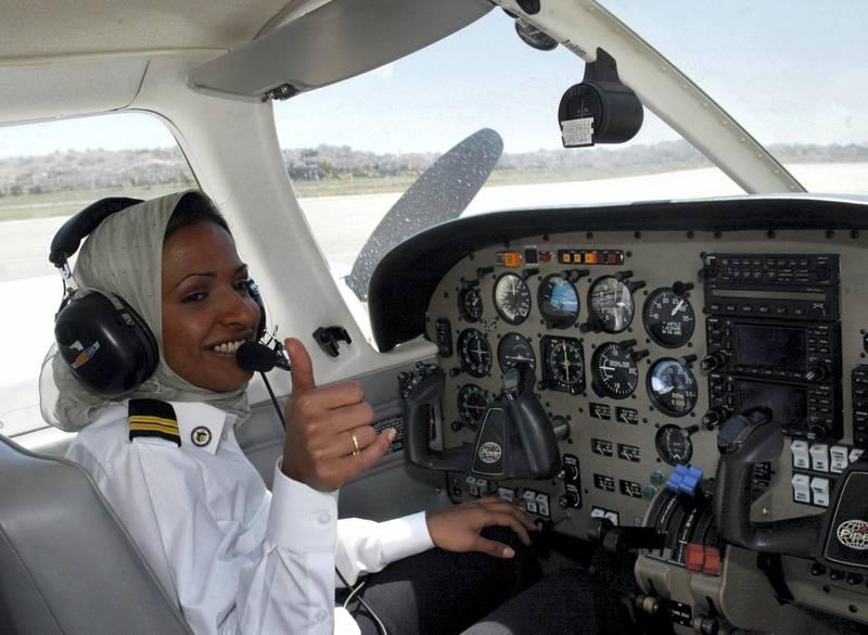 Hanadi Hindi from Saudi Arabia gives the thumbs up as she sits in the cockpit of the American Piper Archor 2000 plane before take off at Marka airport in Amman April 30, 2003. The first ever Saudi woman pilot Hanadi Hindi currently training in Jordan, said flying had given her freedom from conservative traditions and she hopes that women from Saudi Arabia would enjoy one day.
