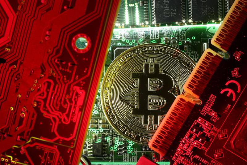 FILE PHOTO: A copy of bitcoin standing on PC motherboard is seen in this illustration picture, October 26, 2017. REUTERS/Dado Ruvic