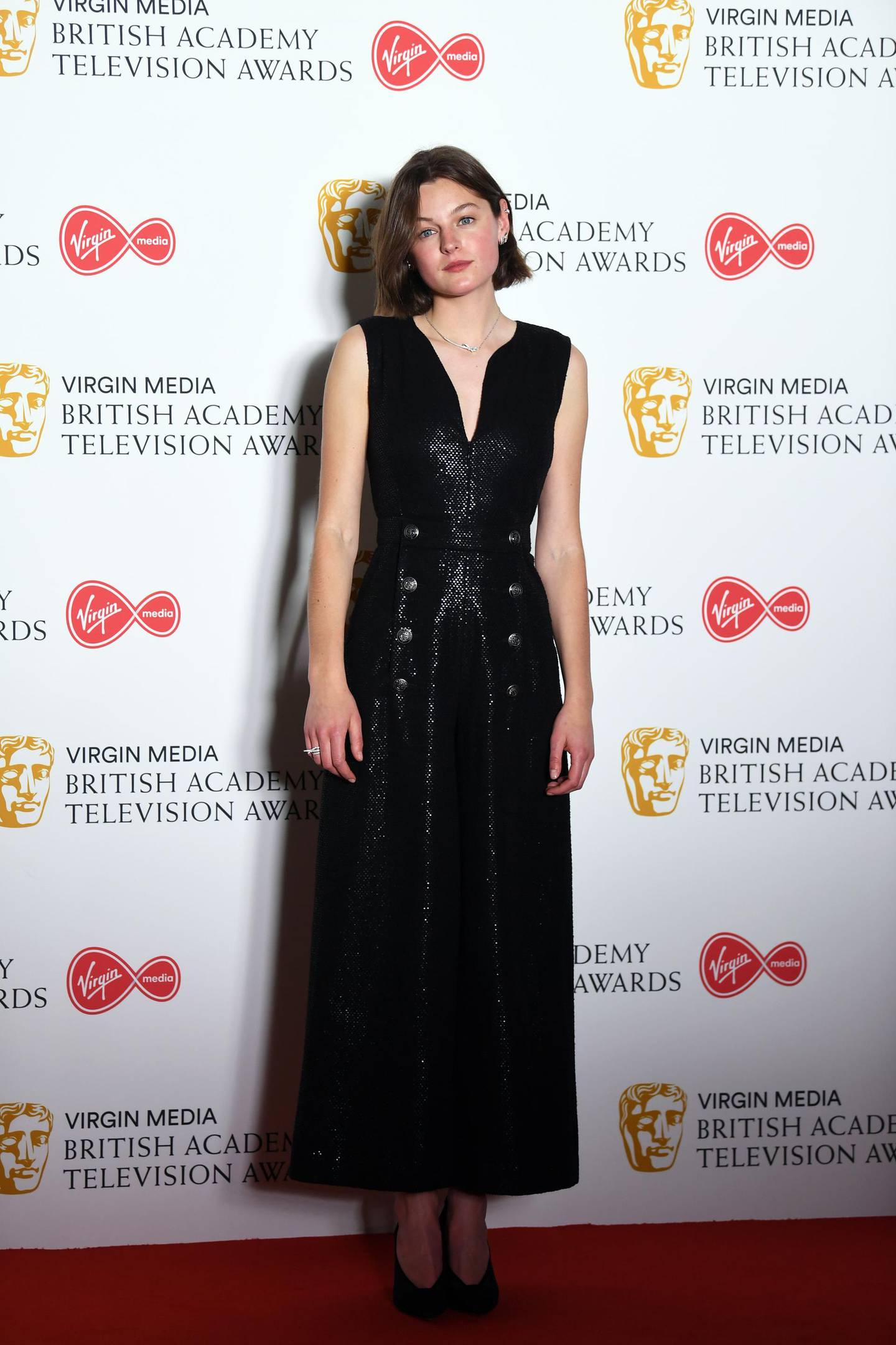 epa07565479 Emma Corrin in the press room at the Virgin Media British Academy Television Awards at the Royal Festival Hall in London, Britain, 12 May 2019. The ceremony is hosted by the British Academy of Film and Television Arts (BAFTA).  EPA-EFE/NEIL HALL