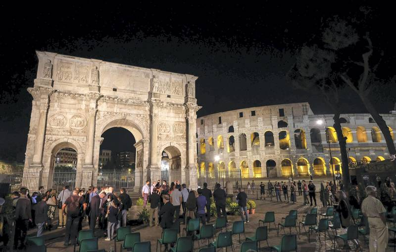 epa08552869 A view of the new lighting of the Arch of Constantine, a triumphal arch next to the Colosseum dedicated to the emperor Constantine the Great, in the center of Rome, Italy, 17 July 2020. The Roman Senate ordered the arch in 312 AD to commemorate Constantine's victory over Maxentius at the Battle of Milvian Bridge.  EPA/ALESSANDRO DI MEO