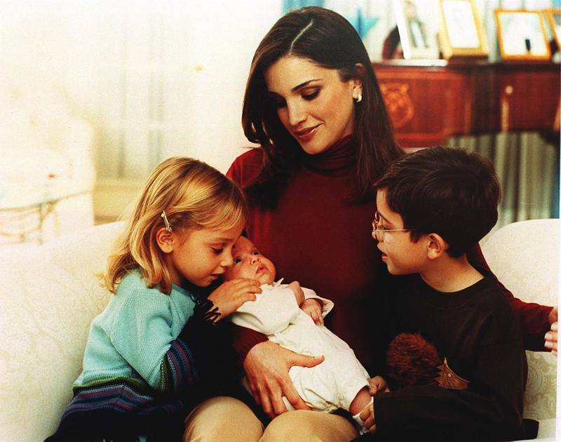 383601 02: Queen Rania of Jordan holds Princess Salma in her arms November 20, 2000 in Amman, Jordan as Princess Eman, left, and Prince Hussein, right, look on. (Photo by Salah Malkawi/Newsmakers)