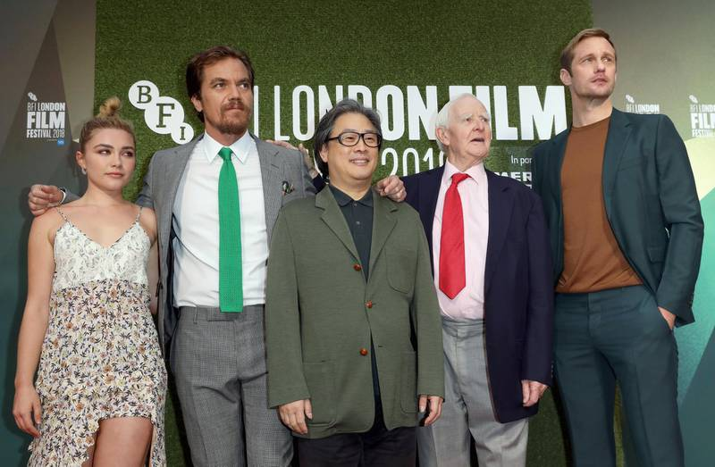 """LONDON, ENGLAND - OCTOBER 14:  (L-R) Florence Pugh, Michael Shannon, Park Chan-wook, John le Carre and Alexander Skarsgard attend the World Premiere of """"The Little Drummer Girl"""" at the 62nd BFI London Film Festival on October 14, 2018 in London, England.  (Photo by Tim P. Whitby/Getty Images for BFI)"""
