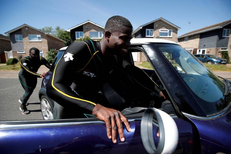 Bobsleigh - Jamaica Bobsleigh team members Shanwayne Stephens and Nimroy Turgott push a Mini Cooper. They have been pushing the car around the streets of Peterborough as part of their training following the outbreak of the coronavirus disease (COVID-19), Peterborough, Britain, May 29, 2020. REUTERS/Paul Childs