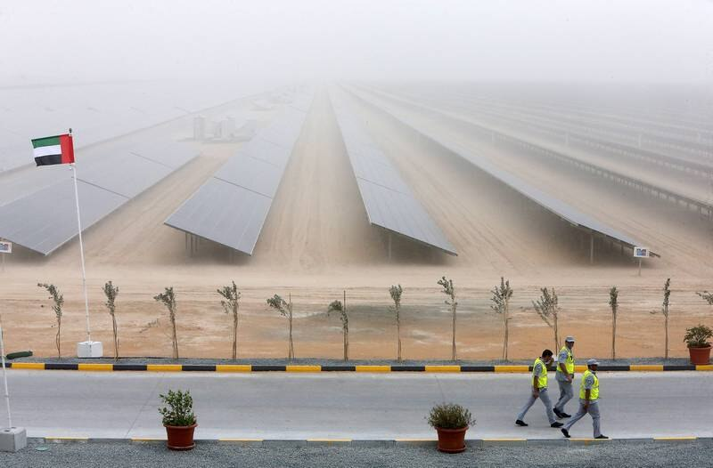 DUBAI , UNITED ARAB EMIRATES – March 20 , 2017 : View of the second phase of the Mohammed bin Rashid Al Maktoum Solar Park in Seih Al Dahal area in Dubai. ( Pawan Singh / The National ) For Business. Story by Andrew. ID No : 14206 *** Local Caption ***  PS2003- SOLAR PARK06.jpg