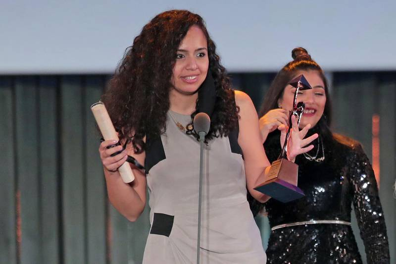"""Egyptian director Mayye Zayed receives the Bronze Pyramid Award for Best First or Second Work """"Lift Like a Girl"""" at the closing ceremony of the 42nd Cairo International Film Festival (CIFF), in Cairo on December 10, 2020.   / AFP / Mahmoud KHALED"""