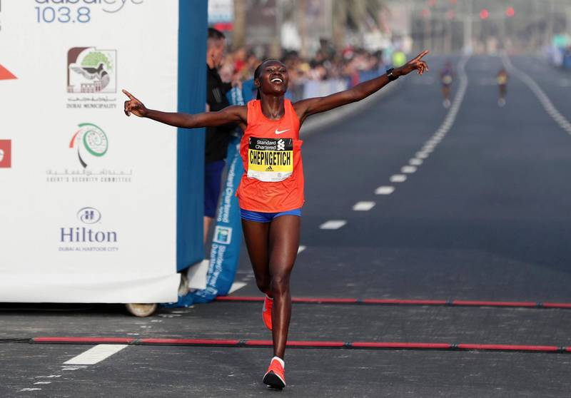 Dubai, United Arab Emirates - January 25, 2019: Ruth Chepngetich wins the womens Standard Chartered Dubai Marathon 2019. Friday, January 25th, 2019 at Jumeirah, Dubai. Chris Whiteoak/The National