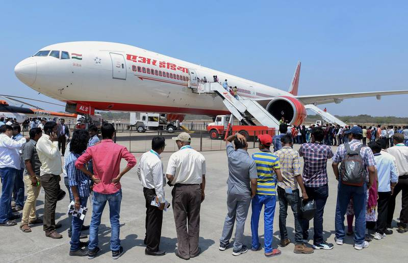 (FILES) In this file photo taken on March 18, 2016, visitors line up to enter an Air India Boeing 777 on display during the India Aviation 2016 airshow at Begumpet airport in Hyderabad. India's airports are struggling to cope with a massive surge in passenger numbers and billions of dollars must be spent to boost their capacity, analysts have warned.  / AFP PHOTO / NOAH SEELAM / TO GO WITH India-economy-aviation,FOCUS by Vishal Manve
