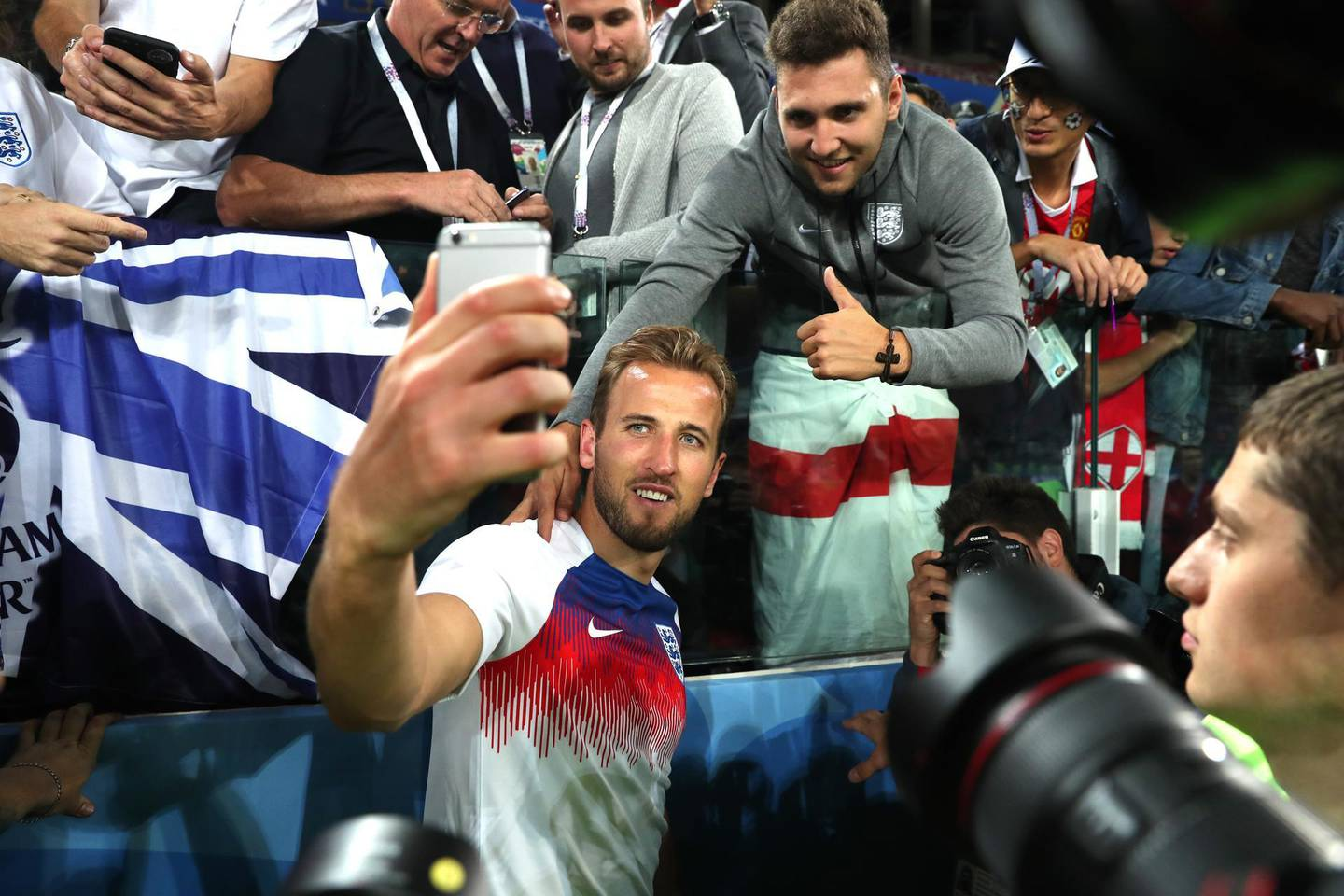MOSCOW, RUSSIA - JULY 03:  Harry Kane of England celebrates victory by taking selfie photogrpahs with fans after the 2018 FIFA World Cup Russia Round of 16 match between Colombia and England at Spartak Stadium on July 3, 2018 in Moscow, Russia.  (Photo by Clive Rose/Getty Images)