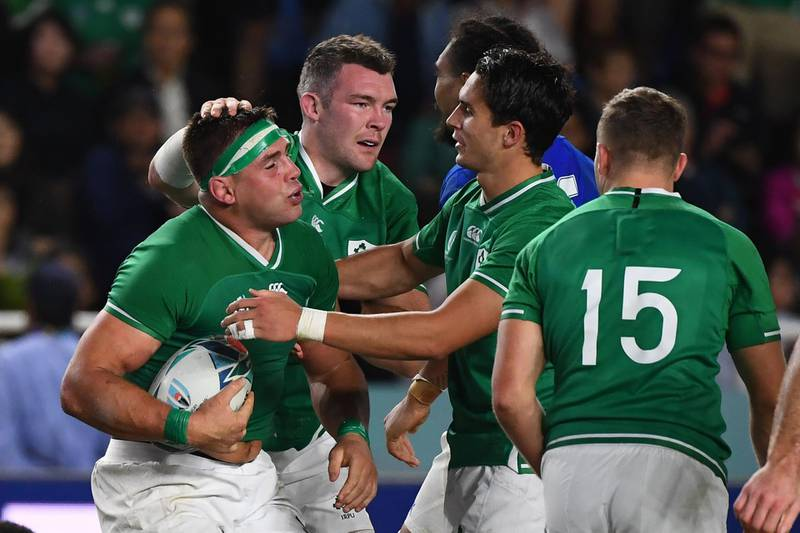 Ireland's number 8 CJ Stander (L) reacts after scoring a try  during the Japan 2019 Rugby World Cup Pool A match between Ireland and Samoa at the Fukuoka Hakatanomori Stadium in Fukuoka on October 12, 2019.  / AFP / GABRIEL BOUYS