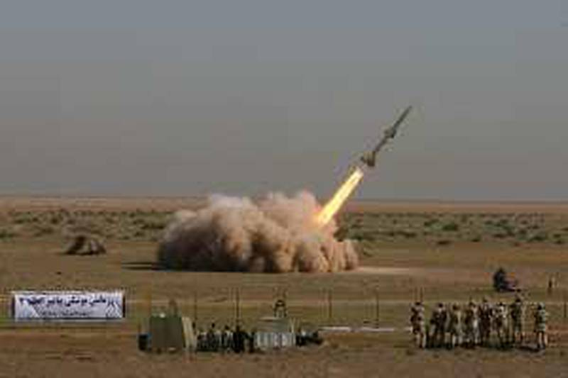 In this photo released by the Iranian semi-official Fars News Agency, Revolutionary Guard's Tondar missile is launched in a drill, Sunday Sept. 27, 2009, near the city of Qom, 80 miles (130 kilometers) south of Tehran, Iran. Iran said it successfully test-fired short-range missiles during military drills Sunday by the elite Revolutionary Guard, a show of force days after the U.S. warned Tehran over a newly revealed underground nuclear facility it was secretly constructing. (AP Photo/Fars News Agency, Ali Shaigan) *** Local Caption ***  VAH103_IRAN_MISSILE.jpg