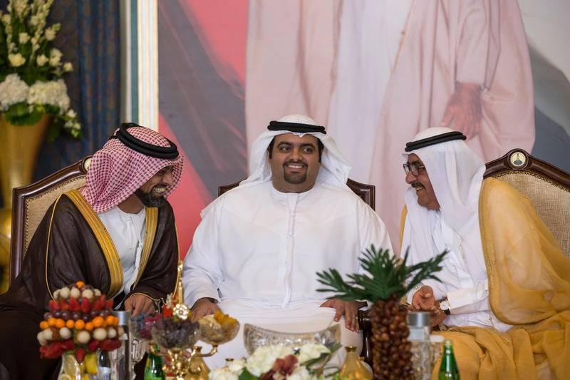 ABU DHABI, UNITED ARAB EMIRATES - March 23, 2016: (L-R) HH Sheikh Ammar bin Humaid Al Nuaimi, Crown Prince of Ajman, HH Sheikh Mohamed bin Hamad Al Sharqi, Crown Prince of Fujairah, and HH Sheikh Hamdan bin Rashid Al Maktoum, Deputy Ruler of Dubai and UAE Minister of Finance, attend the mass wedding reception of HH Sheikh Ahmed bin Nasser bin Zayed Al Nahyan (not shown), HH Sheikh Zayed bin Saeed bin Zayed Al Nahyan (not shown), and other grooms at Armed Forces Officers Club.  ( Ryan Carter / Crown Prince Court - Abu Dhabi ) *** Local Caption ***  20160323RC_C069170.jpg