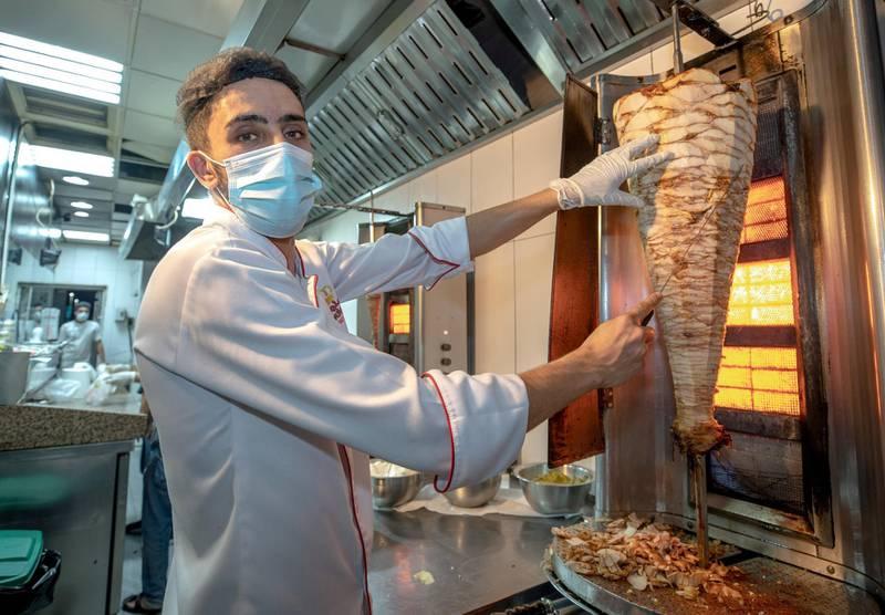 Abu Dhabi, United Arab Emirates, October  12, 2020.  Khalidiya by night article by Saeed Saeed on restaurants, café's on Al Yahar Street.  Basharr from Kings Shawarma.Victor Besa/The NationalSection:  NAReporter:  Saeed Saeed