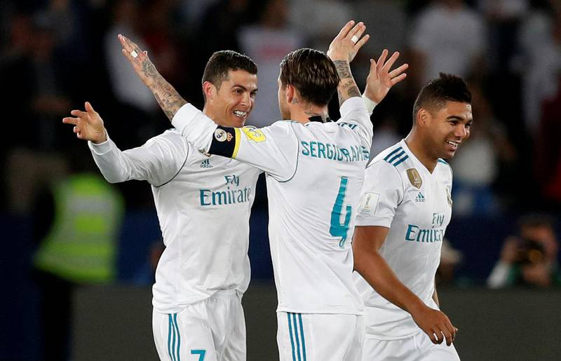 Soccer Football - FIFA Club World Cup Final - Real Madrid vs Gremio FBPA - Zayed Sports City Stadium, Abu Dhabi, United Arab Emirates - December 16, 2017   Real Madrid's Cristiano Ronaldo celebrates with Sergio Ramos after scoring their first goal    REUTERS/Matthew Childs
