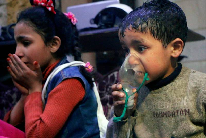 FILE - This file  image released early Sunday, April 8, 2018 by the Syrian Civil Defense White Helmets, shows a child receiving oxygen through a respirator following an alleged poison gas attack in the rebel-held town of Douma, near Damascus, Syria. The Organization for the Prohibition of Chemical Weapons has been thrust once again into the international limelight by a nerve agent attack on a former Russian spy in Britain and allegations of a chemical bombardment on the Syrian city of Douma. It is now attempting to investigate, but its experts have not yet been able to visit the scene. (Syrian Civil Defense White Helmets via AP, File)