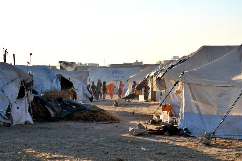 Pictured: Children play inside an IDP camp located on the outskirts of Kandahar city, housing 250 families in 4,000sqm of space. Photo by Charlie Faulkner January 2021