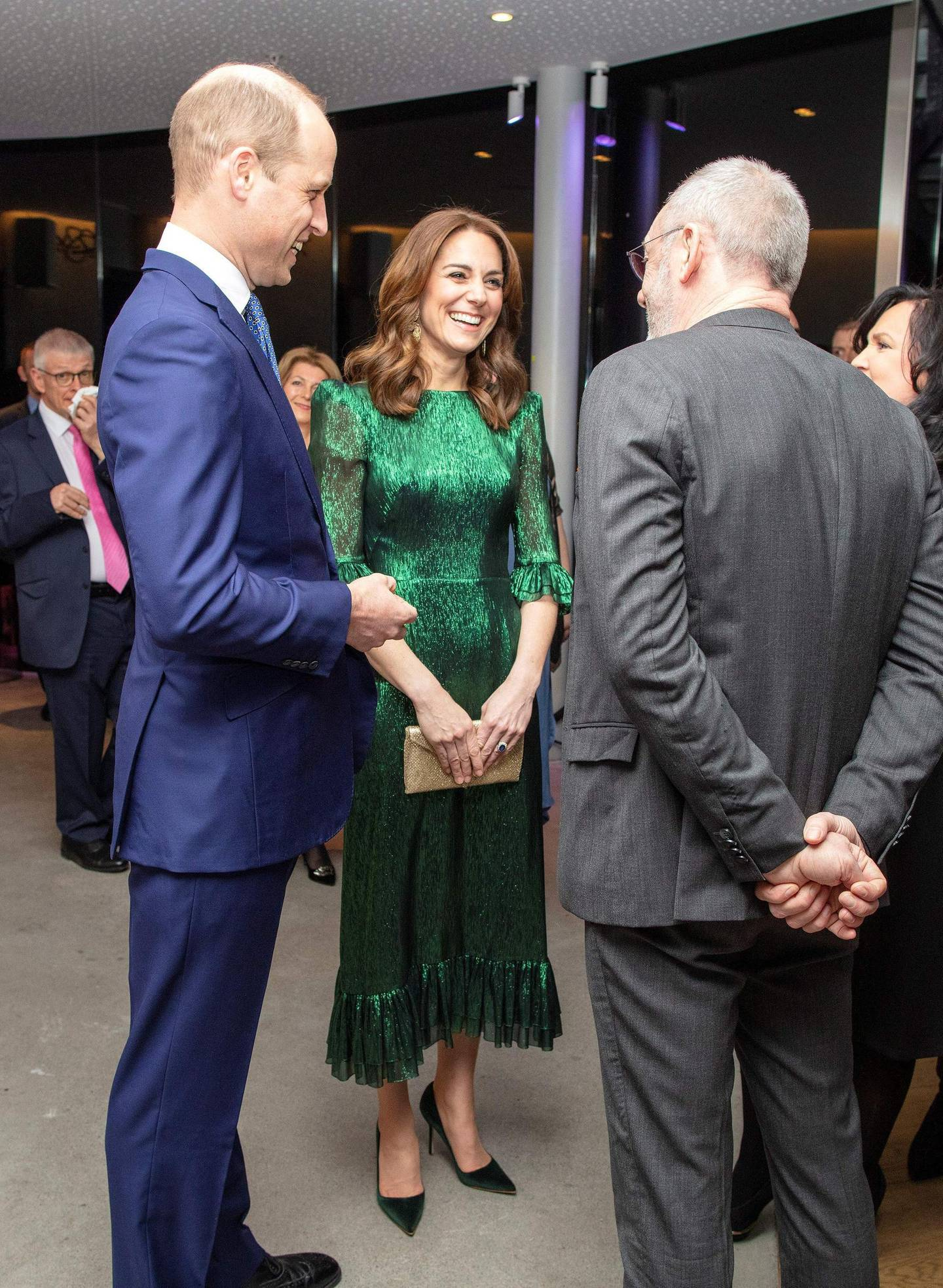 Britain's Prince William, Duke of Cambridge (L), and Catherine, Duchess of Cambridge (C), attend a special reception at the Guinness Storehouse's Gravity Bar in Dublin on March 3, 2020 on the first day of their Royal Highnesses three-day visit.  / AFP / POOL / Paul Faith