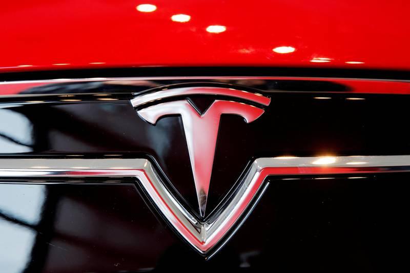 FILE PHOTO: A Tesla logo on a Model S is photographed inside of a Tesla dealership in New York, U.S., April 29, 2016. REUTERS/Lucas Jackson/File Photo